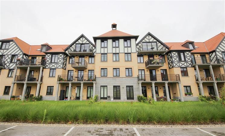 Nieuwbouwappartement met 1 slaapkamer en ondergrondse autostaanplaats te Merelbeke Flora.